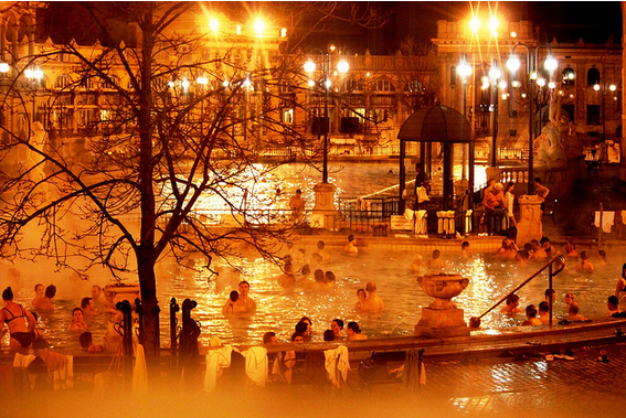Szechenyi Bath in golden lights at night - belissima Budapest